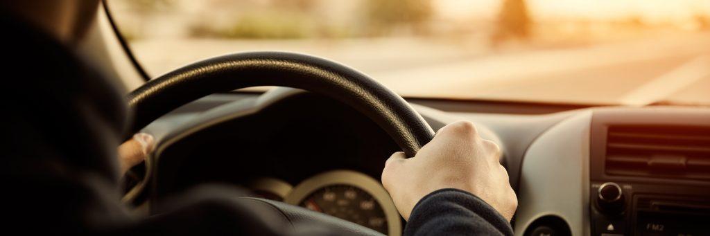 Driving-car-hands-on-steering-wheel